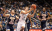 BYU guard Craig Cusick (2) gets fouled in the lane by Northern Arizona guard Stallon Saldivar (21) during the first half of the NCAA basketball game between the BYU Cougars and the Northern Arizona Lumberjacks at Marriott Arena, Thursday, Dec. 27, 2012.
