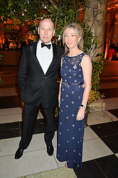 PEREGRINE & CAROLINE ARMSTRONG-JONES at the inaugural dinner for The Queen Elizabeth Scholarship Trust hosted by Viscount Linley at the V&A museum, London on 25th February 2016.