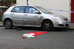 © Licensed to London News Pictures. 04/01/2020. London, UK. A medical kit and a blanket with blood stains on the road within the crime scene on Charteris Road, near the junction with Lennox Road, Finsbury Park in north London. Police launch a murder investigation following a death of a man in his 30s on Friday 3 January 2020. Police were called at approximately 6.50pm to reports of a man stabbed and the he was pronounced dead at the scene just after 7.30pm.  Photo credit: Dinendra Haria/LNP