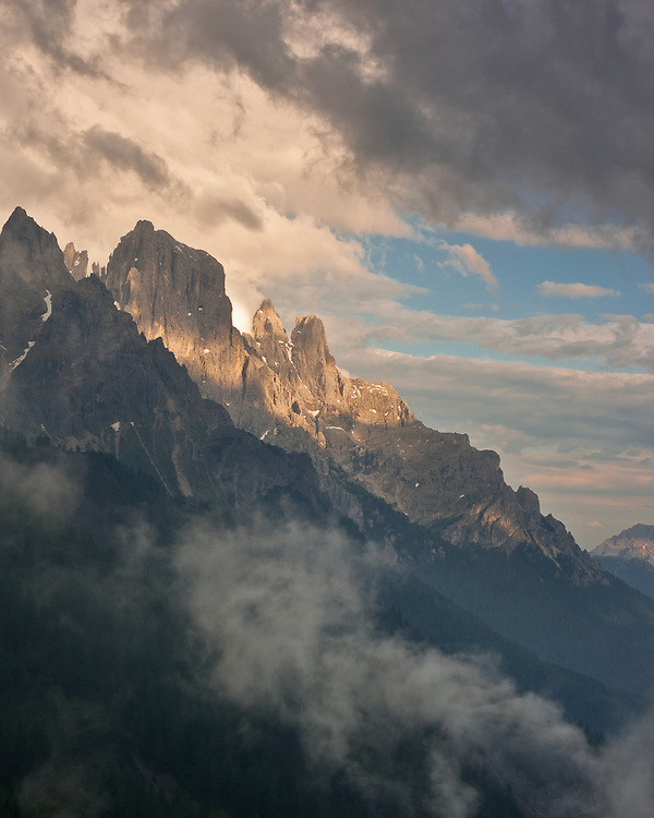 Like a beacon among the clouds, the peaks of Pale San Martino are lit up by the late afternoon light