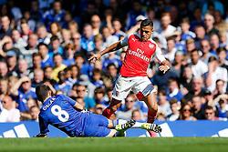 Mesut Ozil of Arsenal is tackled by Oscar of Chelsea - Mandatory byline: Rogan Thomson/JMP - 07966 386802 - 19/09/2015 - FOOTBALL - Stamford Bridge Stadium - London, England - Chelsea v Arsenal - Barclays Premier League.
