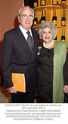 LORD & LADY YOUNG at a reception in London on 25th April 2001.ONF 3