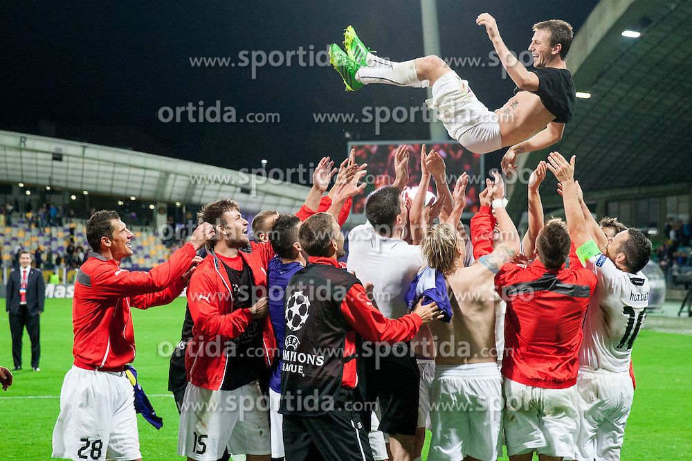Vladimir Darida of Plzen and other players of Viktoria Plzen celebrate after winning and Qualifying to Champions League during Second Leg football match between NK Maribor (SLO) and FC Viktoria Plzen (CZE) of UEFA Champions League 2013/14 Play-Offs on August 28, 2013 in Stadium Ljudski vrt, Maribor, Slovenia. (Photo by Vid Ponikvar / Sportida.com)