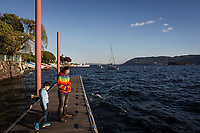 VERBANIA, ITALY - 18 APRIL 2017: A child and his father are seen here by the Lake Maggiore in Verbania, Italy, on April 18th 2017.<br /> <br /> Emma Morano was an Italian supercentenarian who, prior to her death at the age of 117 years and 137 days, was the world's oldest living person whose age had been verified, and the last living person to have been verified as being born in the 1800s. She died on April 15th 2017.