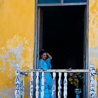 Catagena de Indias , Colombia - December 21 2010 : Girl in a balcony in  an old house