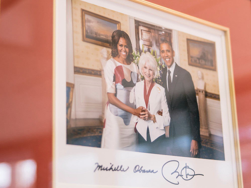 A photograph of Diane Rehm with President Barack Obama and First Lady Michelle Obama hangs on the wall of her office in Washington, D.C.