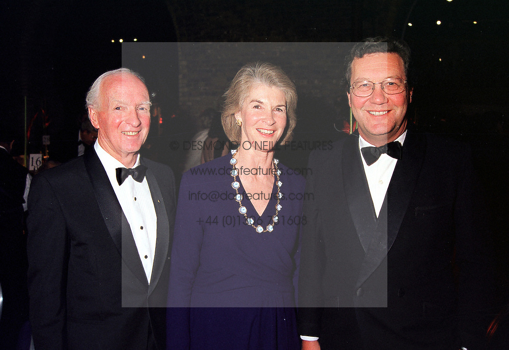 Left to right, The High Commissioner for Australia MR PHILIP FLOOD, MRS PHILIP FLOOD and MR ALEXANDER DOWNER the Australian Minister for Foreign Affairs, at a dinner in London on 26th January 2000.OAK 18