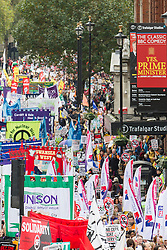 "© Licensed to London News Pictures . 20/10/2012 . London , UK . The march processes up Whitehall towards Trafalgar Square , passing the Trafalgar Studio theatre , showing Yes , Prime Minister . The TUC march in London against austerity and cuts , under the banner "" March for a future that works "" . Photo credit : Joel Goodman/LNP"