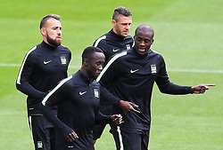 Manchester City's Yaya Toure talks with Bacary Sagna during the training session at the Etihad Stadium ahead of the UEFA Champions League group D match against Juventus - Mandatory byline: Matt McNulty/JMP - 07966386802 - 14/09/2015 - FOOTBALL - Etihad Stadium -Manchester,England - UEFA Champions League