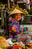 Woman at roadside vegetable market, near Cai Lay, Mekong Delta, Vietnam.