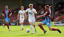 Matt Godden of Peterborough United in action with Rory McArdle of Scunthorpe United - Mandatory by-line: Joe Dent/JMP - 13/10/2018 - FOOTBALL - Glanford Park - Scunthorpe, England - Scunthorpe United v Peterborough United - Sky Bet League One