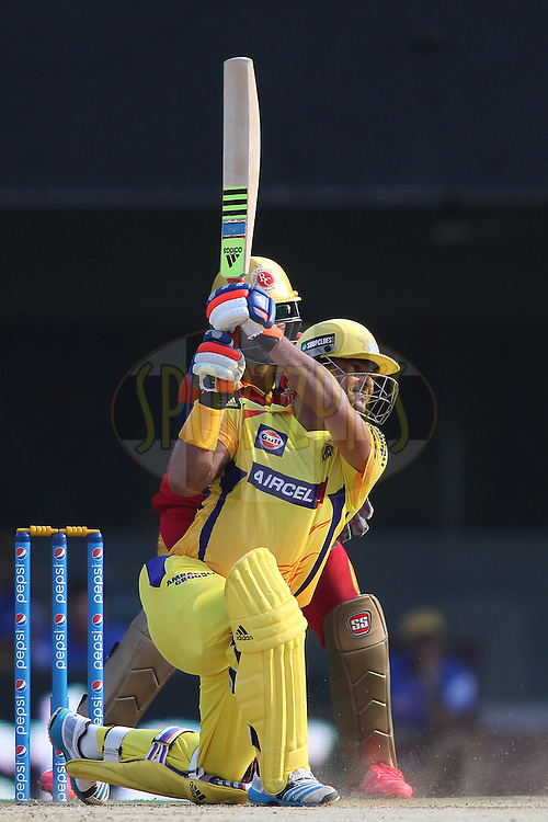 Suresh Raina of Chennai Super Kings drives a delivery through the covers during match 37 of the Pepsi IPL 2015 (Indian Premier League) between The Chennai Superkings and The Royal Challengers Bangalore held at the M. A. Chidambaram Stadium, Chennai Stadium in Chennai, India on the 4th May April 2015.<br /> <br /> Photo by:  Shaun Roy / SPORTZPICS / IPL