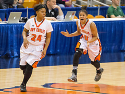 South Charleston guard Aaliyah Dunham (10) celebrates with South Charleston guard Shy'Anne Dunham (24) after making a basket against Greenbrier East during a first round game at the Charleston Civic Center.
