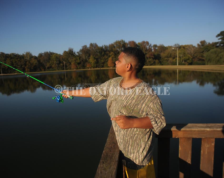 Darick Moody fishes at Pat Lamar Park in Oxford, Miss. on Sunday, October 26, 2014.