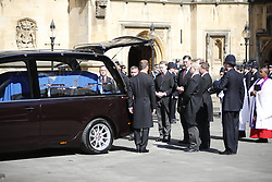 © Licensed to London News Pictures. 09/04/2017. London, UK. The coffin of PC Keith Palmer passes carriage gate at the Houses of Parliament in London as it is taken to the Chapel of St Mary Undercroft within the Palace of Westminster, ahead of his funeral tomorrow (Mon). PC Palmer was killed in a terror attack when Khalid Masood drove a car at pedestrians over Westminster Bridge and then attempted to enter Parliament with a knife. Photo credit: Tolga Akmen/LNP