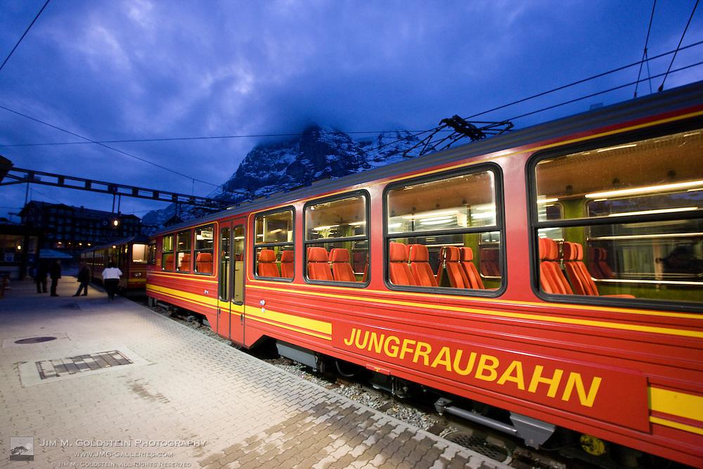 """Jungraubahn train at the Kleine Scheidegg train station on the way to Jungfraujoch """"Top of Europe"""" station - Switzerland"""