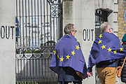 The march passes the IN and Out club on Piccadilly - Unite for Europe march attended by thousands on the weekend before Theresa May triggers article 50. The march went from Park Lane via Whitehall and concluded with speeches in Parliament Square.