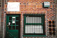Rear entrance of wine shop on Piedmont Avenue, in Oakland, CA.  Copyright 2009 Reid McNally.