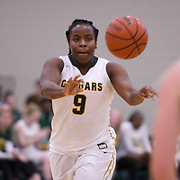 1st year guard Kyanna Giles (9) of the Regina Cougars in action during the home game on January  27 at Centre for Kinesiology, Health and Sport. Credit: Arthur Ward/Arthur Images