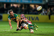 James Wilson of Northampton Saints (left) gets his pass away during the Aviva Premiership match at Franklin's Gardens, Northampton<br /> Picture by Andy Kearns/Focus Images Ltd 0781 864 4264<br /> 05/09/2014