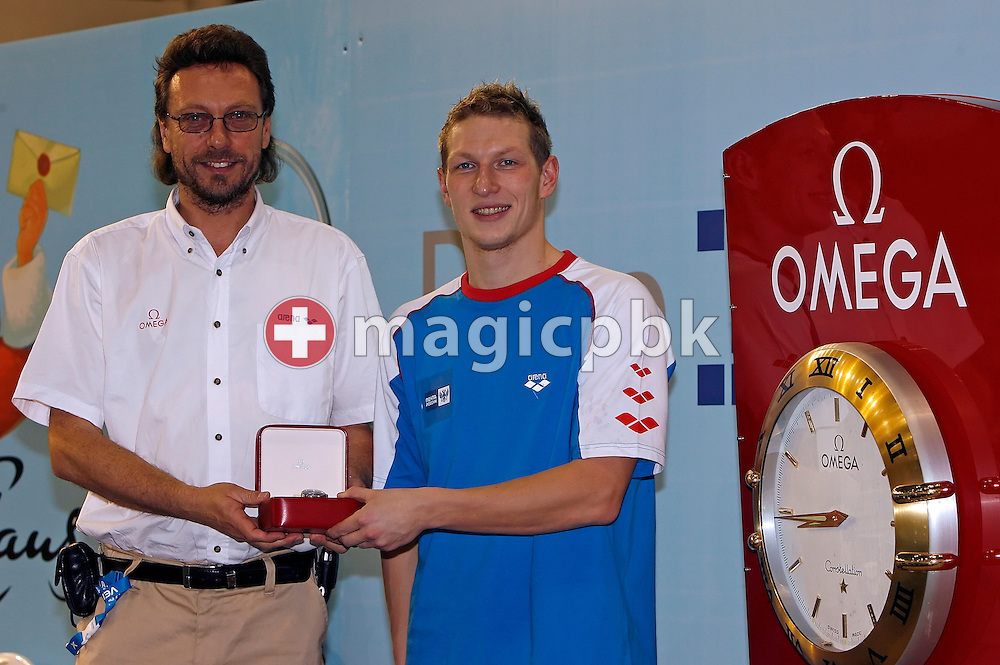 Omega represent Daniel Kohler (L) hands over to Yury Prilukov (R) of Russia an Omega watch for the best male performance on day three at the European Short-Course Swimming Championships at the Maekelaenrinne Swimming Centre in Helsinki, Finland, Saturday December 9, 2006. (Photo by Patrick B. Kraemer / MAGICPBK)