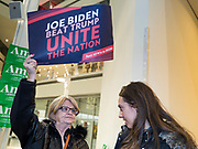 03 FEBRUARY 2020 - DES MOINES, IOWA: MARY MULLEN and MADELINE MEYER, both caucusing for Joe Biden, wait for the caucus to start at precinct 55 in downtown Des Moines. More than 1,000 voters registered to participate in precinct 55 caucus. The precinct awarded 14 delegates during its caucus. Pete Buttigieg was awarded 5, Bernie Sanders was awarded 5 and Elizabeth Warren was awarded 4.   PHOTO BY JACK KURTZ