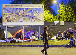03.10.2015, Grenzübergang, Salzburg - Freilassing, GER, Flüchtlingskrise in der EU, im Bild ein Werbeschild der Salzburger Festspiele im improvisierten Camp // an advertising sign at the Salzburg Festival in the improvised camp. Europe is dealing with its greatest influx of migrants and asylum seekers since World War II as immigrants fleeing war and poverty in the Middle East, Afghanistan and Africa try to reach Germany and other Western European countries, German - Austrian Border, Salzburg on 2015/10/03. EXPA Pictures © 2015, PhotoCredit: EXPA/ JFK