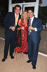 Left to right, ROSS BURDEN, LIZ BREWER and REMI KRUG at a summer party hosted by champagne house Krug held at Debbenham House, 8 Addison Road, London on 28th June 2005.<br />