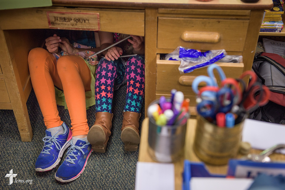 4th grade students huddle under a desk during quiet reading time on Thursday, Oct. 27, 2016, at First Immanuel Lutheran School in Cedarburg, Wis. LCMS Communications/Erik M. Lunsford