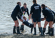 London, Great Britain, OUWBC crew members, throwing the cox into the river, after winning the Newton Women's Boat Race.  Newton Women's Boat race and the reserve races Mortlake. ENGLAND. <br /> <br /> OUWBC Crew: <br /> Maxie SCHESKE, Anastasia CHITTY, Shelley PEARSON, Lauren KEDAR, Maddy BADCOTT, Emily REYNOLDS, Nadine GRAEDEL IBERG, Caryn DAVIES and Cox Jennifer EHR<br /> <br /> <br /> 17:25:22  Saturday  11/04/2015<br /> <br /> [Mandatory Credit; Intersport-images]