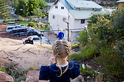 "Aug 9, 2008 -- COLORADO CITY, AZ: Jessop children play in the backyard of their home in Colorado City, AZ. Colorado City and neighboring town of Hildale, UT, are home to the Fundamentalist Church of Jesus Christ of Latter Day Saints (FLDS) which split from the mainstream Church of Jesus Christ of Latter Day Saints (Mormons) after the Mormons banned plural marriage (polygamy) in 1890 so that Utah could gain statehood into the United States. The FLDS Prophet (leader), Warren Jeffs, has been convicted in Utah of ""rape as an accomplice"" for arranging the marriage of teenage girl to her cousin and is currently on trial for similar, those less serious, charges in Arizona. After Texas child protection authorities raided the Yearning for Zion Ranch, (the FLDS compound in Eldorado, TX) many members of the FLDS community in Colorado City/Hildale fear either Arizona or Utah authorities could raid their homes in the same way. Older members of the community still remember the Short Creek Raid of 1953 when Arizona authorities using National Guard troops, raided the community, arresting the men and placing women and children in ""protective"" custody. After two years in foster care, the women and children returned to their homes. After the raid, the FLDS Church eliminated any connection to the ""Short Creek raid"" by renaming their town Colorado City in Arizona and Hildale in Utah. A member of the Jessop family weeds the community corn plot in Colorado City, AZ. The Jessops are a polygamous family and members of the FLDS. Photo by Jack Kurtz / ZUMA Press"