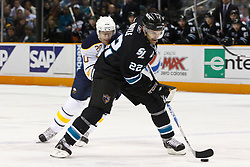 January 6, 2011; San Jose, CA, USA; San Jose Sharks defenseman Dan Boyle (22) skates with the puck past Buffalo Sabres center Rob Niedermayer (20) during the first period at HP Pavilion. Buffalo defeated San Jose 3-0. Mandatory Credit: Jason O. Watson / US PRESSWIRE