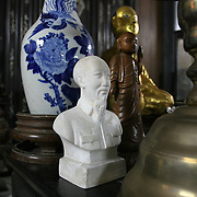 A bust of Revolutionary leader Ho Chi Minh finds its way onto an alter meant for ancestral worship in the Mekong Delta. The delta is Vietnam's rice basket - the beating heart of the communist nation's movement towards modernity. With Vietnam's greatest population density, the fertile delta is home to an ever growing amount of industrialisation and mechnanized agriculture. Days of simple agrarian subsitence - conical hats toiling in quiet rice fields - have given way to the rise of cities, bridges, factories, production plants and foreign investment and tourism.