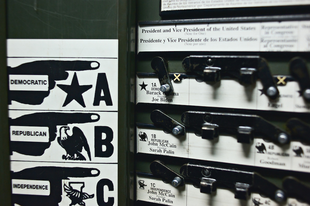 Interior of voting booth, showing lever in position to vote for Democrats Barack Obama and Joe Biden, also showing names of Republicans John McCain and Sarah Palin, Election Day 2008, Yonkers, New York, US.