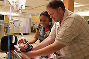 Tranisha and Doug Misenheimer hold their twin daughters, Zyan and Zoie, Friday at Round Rock Medical Center;  Non profit organization, Hand to Hold and St. David's Medical Center sponsored a brunch honoring families who had children in the NICU.