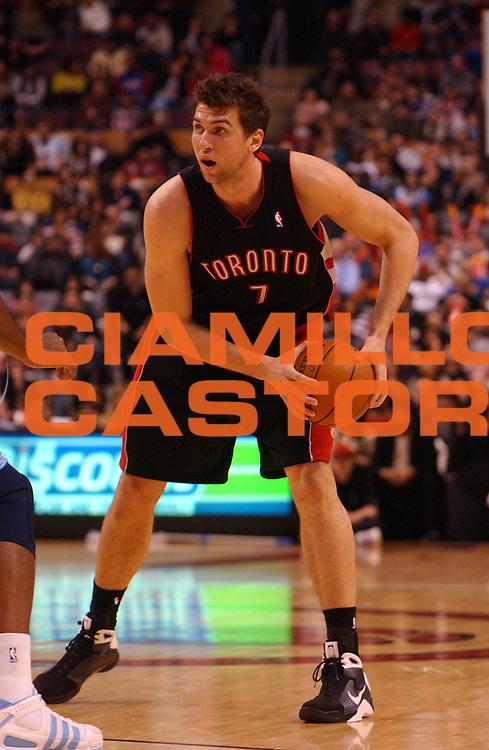 DESCRIZIONE : Toronto Campionato NBA 2008-2009 Toronto Raptors Denver Nuggets<br /> GIOCATORE : Andrea Bargnani<br /> SQUADRA : Toronto Raptors Denver Nuggets<br /> EVENTO : Campionato NBA 2008-2009 <br /> GARA : Toronto Raptors Denver Nuggets<br /> DATA : 31/12/2008<br /> CATEGORIA :<br /> SPORT : Pallacanestro <br /> AUTORE : Agenzia Ciamillo-Castoria/V.Keslassy<br /> Galleria : NBA 2008-2009<br /> Fotonotizia : Toronto Campionato NBA 2008-2009 Toronto Raptors Denver Nuggets<br /> Predefinita :