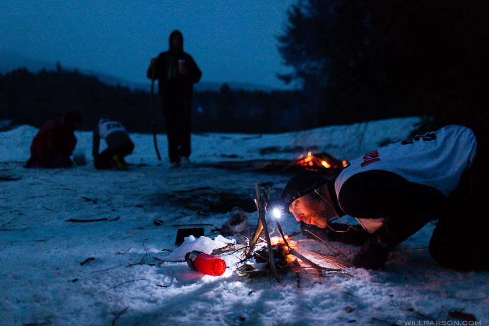 Rob Belley of Marshfield, Mass., tries to start a fire without matches, one of the challenges during the second day of the Peak Winter Death Race in Pittsfield, Vt., on February 1, 2014. (Valley News - Will Parson)