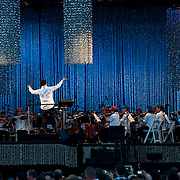July 13, 2013 - New York, NY : <br /> The New York Philharmonic, lead by Alan Gilbert, standing at center left, perform in the free MLB All-Star Charity Concert to benefit Hurricane Sandy victims, in Central Park's great lawn on July 13, 2013. Pop star Mariah Carey (not pictured) made a guest appearance. <br /> CREDIT: Karsten Moran for The New York Times