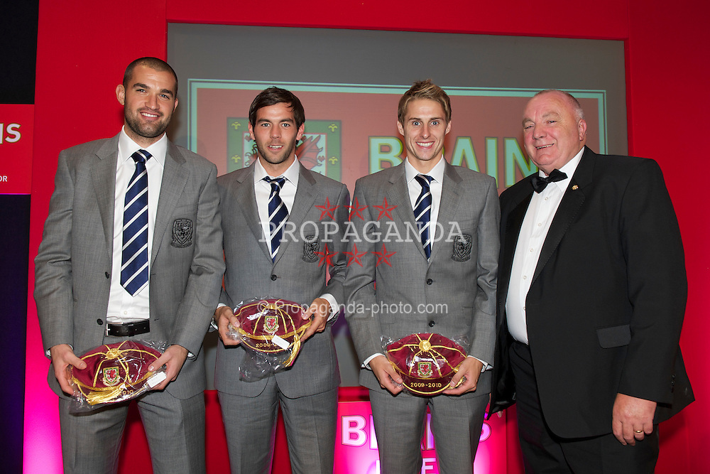 CARDIFF, WALES - Monday, October 4, 2010: Wales players goalkeeper Boaz Myhill, Joe Ledley and David Edwards receive their international caps from FAW Vice-President Trefor Lloyd-Hughes at the Brains Football Association of Wales Player of the Year Awards. (Pic by David Rawcliffe/Propaganda)