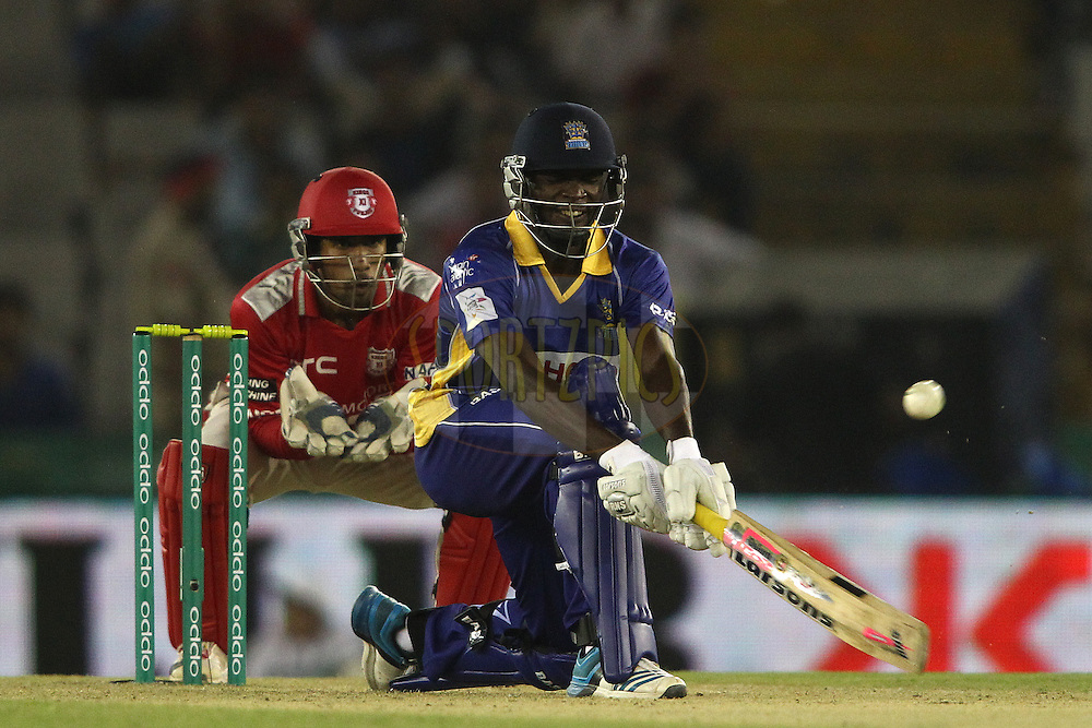 Jonathan Carter of the Barbados Trident reverse sweeps a delivery during match 5 of the Oppo Champions League Twenty20 between the Kings XI Punjab and the Barbados Tridents held at the Punjab Cricket Association Stadium, Mohali, India on the 20th September 2014<br /> <br /> Photo by:  Shaun Roy / Sportzpics/ CLT20<br /> <br /> <br /> Image use is subject to the terms and conditions as laid out by the BCCI/ CLT20.  The terms and conditions can be downloaded here:<br /> <br /> http://sportzpics.photoshelter.com/gallery/CLT20-Image-Terms-and-Conditions-2014/G0000IfNJn535VPU/C0000QhhKadWcjYs