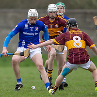 Kilmaley's Conor Cleary is challenged by Tulla's Paraig Mulconroy and Colm McInerney
