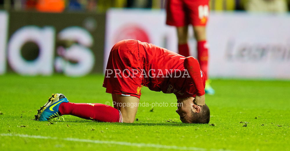 SWANSEA, WALES - Monday, September 16, 2013: Liverpool's Iago Aspas looks dejected after missing a chance in injury time during the Premiership match against Swansea City at the Liberty Stadium. (Pic by David Rawcliffe/Propaganda)