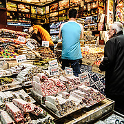 Customers buying Turkish Delight and other sweets at a confectionary shop next to the Spice Bazaar (also known as the Egyption Bazaar) in Istanbul, Turkey.