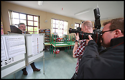 Sinn Fein's Party leader Gerry Adams perpares his vote for local and European Elections at Doolargy National School in Ravensdale, County Louth, Ireland,  Friday May 23rd. Polling stations will remain open until 10pm. Almost 2,000 candidates are contesting the 949 local authority seats, while 41 hopefuls are in the race for 11 MEP seats spread over three constituencies while counting has begun in the local elections in Northern Ireland. Over 900 candidates are competing for the 462 seats on 11 new local authorities. Final results are expected to be known by tomorrow afternoon. Counting in the European Elections begins in Belfast on Monday morning..Friday, 23rd May 2014. Picture by  i-Images / i-Images