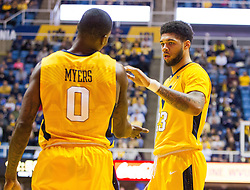 Dec 10, 2016; Morgantown, WV, USA; West Virginia Mountaineers forward Esa Ahmad (23) celebrates with West Virginia Mountaineers guard Teyvon Myers (0) during the first half against the Virginia Military Keydets at WVU Coliseum. Mandatory Credit: Ben Queen-USA TODAY Sports