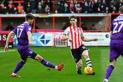 Alex Hartridge (34) of Exeter City is challenged by Harry Cardwell (17) of Grimsby Town during the EFL Sky Bet League 2 match between Exeter City and Grimsby Town FC at St James' Park, Exeter, England on 29 December 2018.