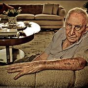 """PORTRAITS OF SURVIVORS AND IMMIGRANTS <br /> Sobreviviente del Holocausto / Holocaust Survivor.<br /> <br /> Sr. Oscar Gross.<br /> <br /> Nació el 3 de julio de 1926 en Cieszyn, Polonia. En 1941, cuando los nazis ocuparon la ciudad, formó el gueto y debió trabajar bajo las órdenes de la SS. Fue trasladado con su familia al campo de tránsito de Dulag y allí separados. Él y su hermano recorrieron un sinnúmero de campos de trabajo hasta llegar finalmente  a Blechhammer. En una de las llamadas """"Marchas de la muerte"""" lograron escapar, pero dos semanas después fueron apresados de nuevo por la casi moribunda SS y llevados a Mauthausen. Fue liberado y conducido a Italia, desde donde pudo llegar a Israel y luego a Venezuela.<br /> <br /> Photography by Aaron Sosa<br /> Caracas - Venezuela 2010<br /> (Copyright © Aaron Sosa)"""