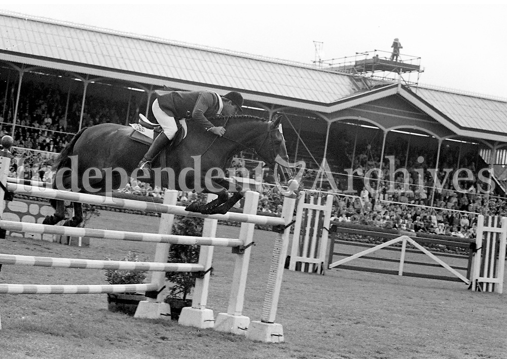 The RDS horse show, Harvey Smith on &quot;MAttie Brown&quot; jumping the last flight on his way to winning the International Grand Prix. August 9 1970. <br /> (Part of the Independent Newspapers Ireland/NLI collection.)
