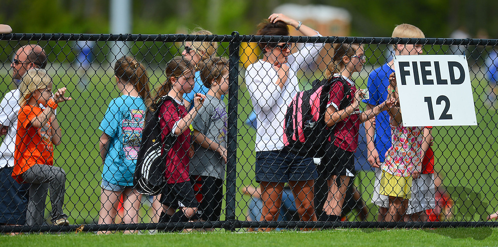 Gary Cosby Jr./Decatur Daily   The Open Cup Soccer tournament concludes Sunday at the Jack Allen Recreation Complex in Decatur Sunday.  The tournament featured teams from across the region and several from outside the country.  Children in line for concessions watch a game through the fence.