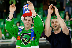 Miha Verlic (HDD Tilia Olimpija, #91) as the man of the match and Scott Hotham (HDD Tilia Olimpija, #5) after ice-hockey match between HDD Tilia Olimpija and KHL Medvescak Zagreb in 47th Round of EBEL league, on January 27, 2012 at Hala Tivoli, Ljubljana, Slovenia. HDD Tilia Olimpija defeated KHL Medvescak Zagreb 6:4. (Photo By Matic Klansek Velej / Sportida)